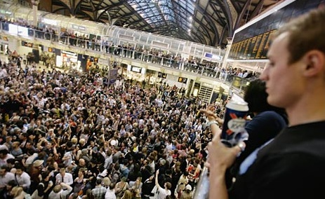 Image from BBC News, Revelers at Liverpool Street Station.