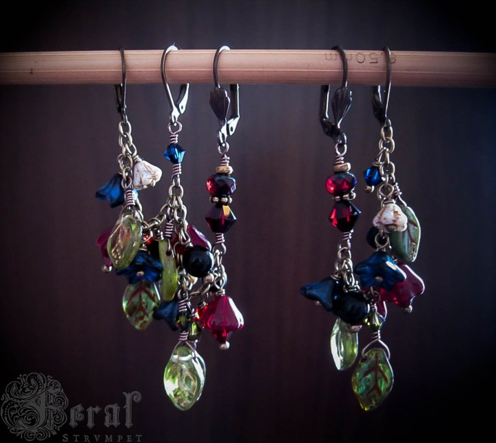 Another view of the illuminated manuscript ear chains
