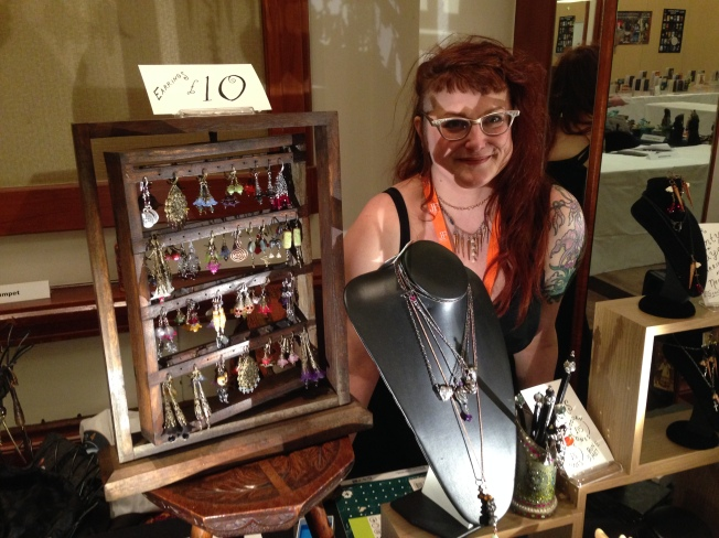 Me wearing my Slayer Queen Bib Necklace at my booth at the British Science Fiction Convention.