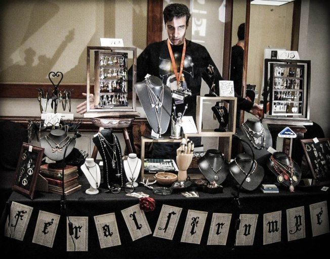 Mike manning the stall with sinister flair at Eastercon