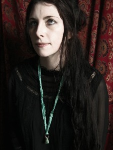 Catherine wearing the wrapped chrysoprase pendant necklace.
