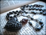 Black Hearted Love-- vintage rosary fragments given a new life.